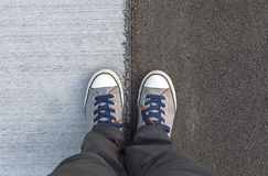 Top of view sneakers on a road. Royalty Free Stock Images