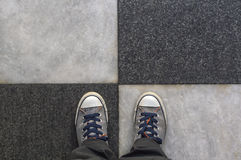 Top of view sneakers on a road. Stock Photography