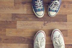Top view sneakers on wooden floor Stock Image