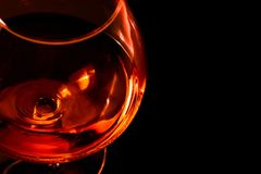 Top of view of snifter of brandy in elegant typical cognac glass on black background Stock Images