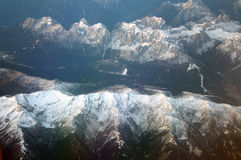 Top view, snow-capped mountains. Top view through the window, snow-capped mountains Royalty Free Stock Photos