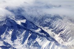 Top view on snow mountains and glacier in mist Royalty Free Stock Images