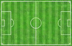 Top view of soccer football field green grass with white line an. D grain Royalty Free Stock Images