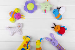 Top view with soft baby toys on wooden background Stock Photos