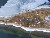 Top view at Sorve Peninsula with buildings and lighthouse. Baltic sea at spring season. Saaremaa, Estonia, Europe. Top view at Sorve Peninsula with buildings and Royalty Free Stock Image
