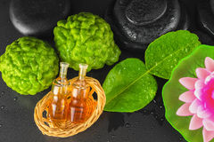 Top view of spa concept bergamot, leaf, fragrance oil, lotus and Stock Photos