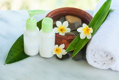 Spa or wellness setting with tropical flowers with sunlight royalty free stock images