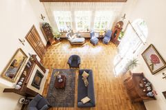 Top view of a spacious living room interior with a fireplace, bl royalty free stock photo