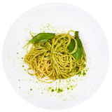 Top view spaghetti mixed with pesto Stock Photo