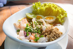 Top view spicy seafood Salad ingredient with squid shrimp fish and egg Thai food Royalty Free Stock Photography