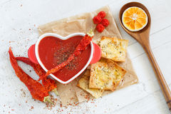 Top view of a spicy tomato soup with chili pepper and cheese crackers Stock Images