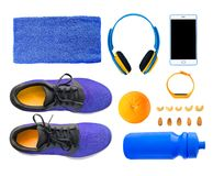 Fitness shoes and accessories isolated. Top view of sport accessories and equipment for fitness and training. Running shoes, smartphone, bottle etc. isolated on Royalty Free Stock Images