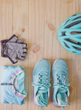 Top view of sport equipment in pastel colour on wooden background Royalty Free Stock Image