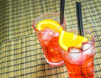 Top of view of spritz aperitif aperol cocktail with two orange slices and ice cubes Stock Images