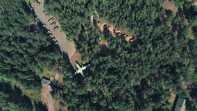 Top view spy drone shooting a russian military base with airplanes