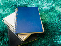 Top view stack of book on the carpet Royalty Free Stock Photos
