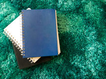 Top view stack of book on the carpet Royalty Free Stock Images