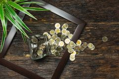 Top view of stack of coin in the frame accounting concept on woo. Den background royalty free stock images