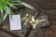 Top view of stack of coin in the frame accounting concept on woo. Den background stock photography