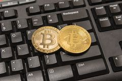 Golden Bitcoin Cryptocurrency on computer keyboard Royalty Free Stock Photography