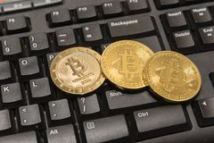 Golden Bitcoin Cryptocurrency on computer keyboard Stock Images