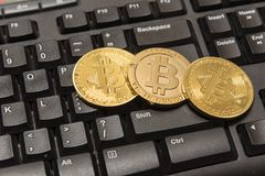 Golden Bitcoin Cryptocurrency on computer keyboard Stock Photography