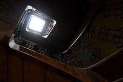 Top view of staircase going down. Beautiful staircase in old building stock image