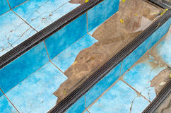 Top view of the stairs close-up of a broken blue tiles Stock Photos