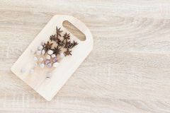 Top view Star anise and garlic on wood chopping board Stock Image