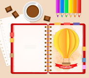 Top view of stationary pencils, red cover notebook and coffee cup with chocolate, paper 3D craft air balloon Stock Image