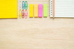Top view of stationery items on wooden background Stock Photos