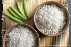 Top view: steamed cooked white basmati rice in round ceramic bowls over black stone Royalty Free Stock Photography