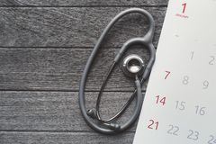 Top view of stethoscope and calendar on the table background Royalty Free Stock Images