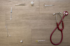 Top view of stethoscope and medical supplies on wood floor Stock Photos