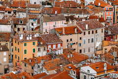 Top view of the stone houses with red-tiled roofs in a European city Stock Photo