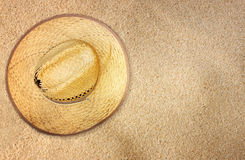 Top view of straw hat on beach sand Royalty Free Stock Images