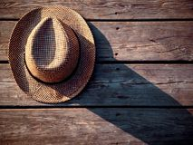 Top view of straw hat on the wooden background. Horisontal image.  Stock Photo