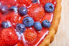 Top view of strawberry and blueberry cake with jelly Royalty Free Stock Photo