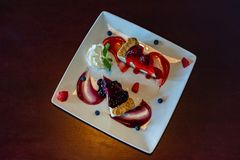 Top view of strawberry and blueberry cheesecake with fresh strawberry and blueberry stock photo