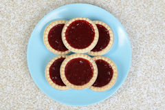 Top view strawberry tarts on blue plate Royalty Free Stock Photos
