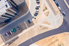 Top view of street with parking lot near new residential housing complex stock image