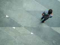 Top view on street people. BANGKOK, THAILAND - February 2, 2017:  Top view on street people play and talk with the smart phone on the concrete pedestrian Royalty Free Stock Image