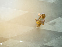 Top view on street people. BANGKOK, THAILAND - February 2, 2017:  Top view on street people play and talk with the smart phone on the concrete pedestrian Royalty Free Stock Photography