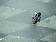 Top view on street people. BANGKOK, THAILAND - February 2, 2017:  Top view on street people play and talk with the smart phone on the concrete pedestrian Stock Photography