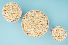 Top view of striped popcorn buckets of different sizes isolated