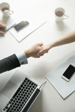 Top view of a strong handshake between man and woman Royalty Free Stock Photo