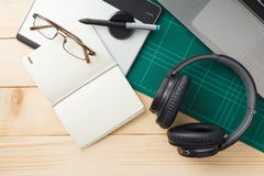Stuff and gadgets on wooden desk. Top view of stuff and gadgets on wooden desk with graphic designer equipment. flat lay style Stock Photos