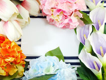 Top view of stylish branding mockup with flowers to display your artworks Royalty Free Stock Photography