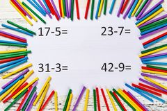 Subtraction equations with colorful counting rods. Top view subtraction equations with colorful counting rods royalty free stock image