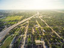 Top view suburban neighborhood near interstate I69 highway in Ho. Aerial view of residential houses neighborhood in suburban area of downtown Houston next to royalty free stock images